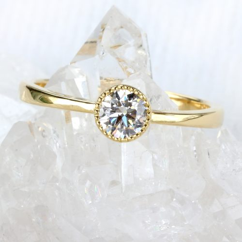 custom diamond solitaire ring in 18ct gold