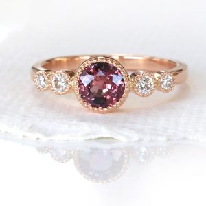 Custom sapphire and diamond engagement ring in 18ct rose gold