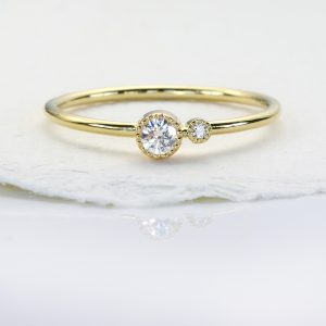 April birthstone stacking ring, set with a Canadian fair trade diamond. 18ct gold ring