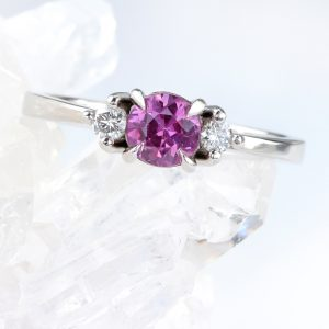 A breathtaking platinum pink sapphire and diamond engagement ring by ethical jewellery designer Lilia Nash. Shop online or create a bespoke version.