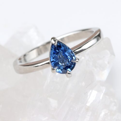 One of a kind pear cut blue sapphire ring in 950 platinum. Available now in UK ring size L. Free Worldwide delivery.
