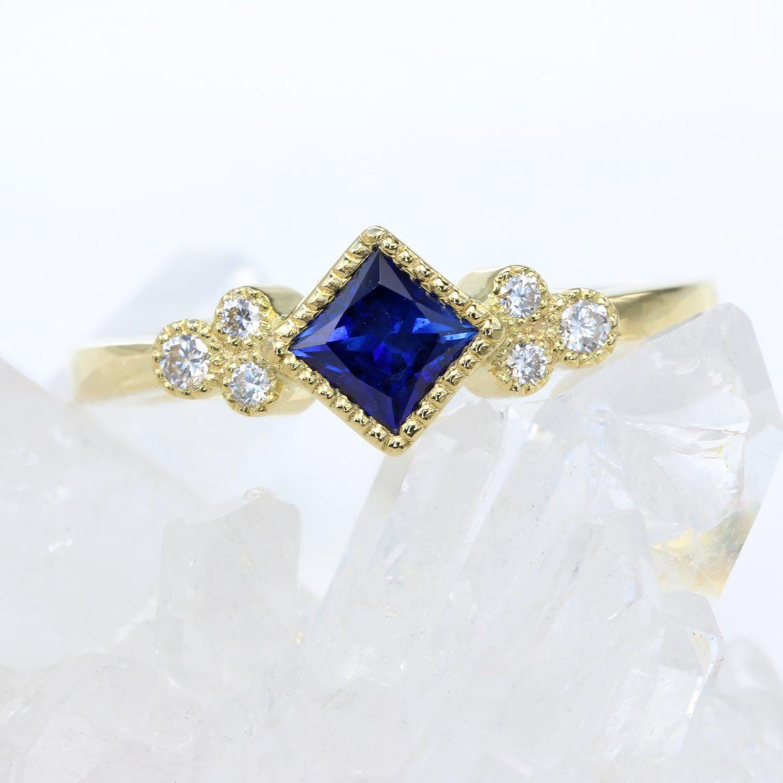 Princess cut sapphire and diamond trilogy ring 18ct gold